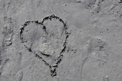 heart symbol in sand