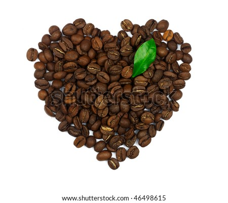 Heart symbol made of coffee beans with green leaf isolated on white background