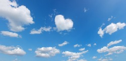 heart symbol shape cloud over blue panoramic sky. love theme background. high resolution