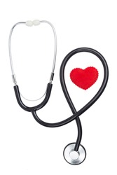 heart symbol with a stethoscope over white background