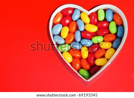Heart with Colorful Jellybean Candy on a Bright Red Background