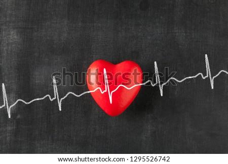 Heart with heartbeat on chalk board  #1295526742