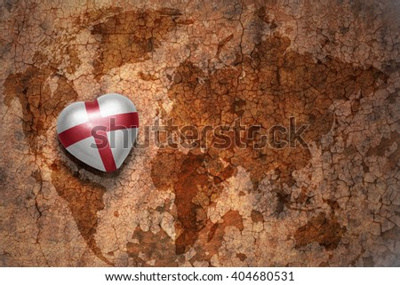 Heart With National Flag Of England On A Vintage World Map Crack Paper Background Concept