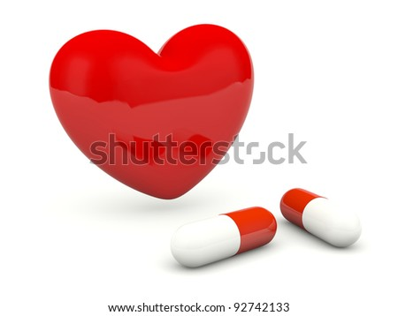 Heart with pills isolated on white