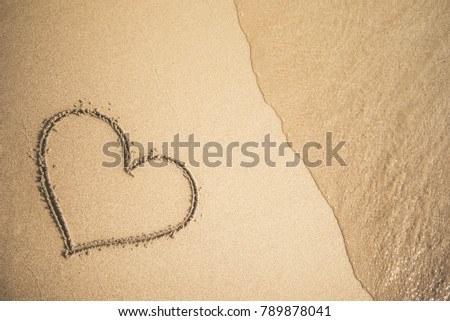 Heart written on the sand #789878041