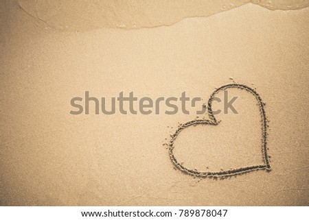 Heart written on the sand #789878047