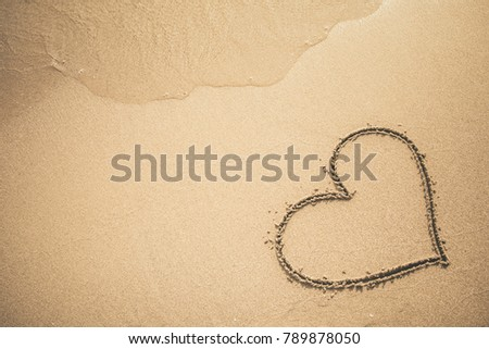 Heart written on the sand #789878050