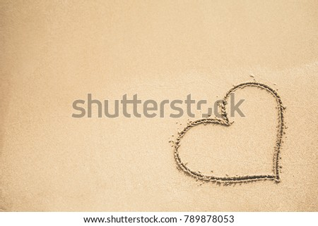 Heart written on the sand #789878053
