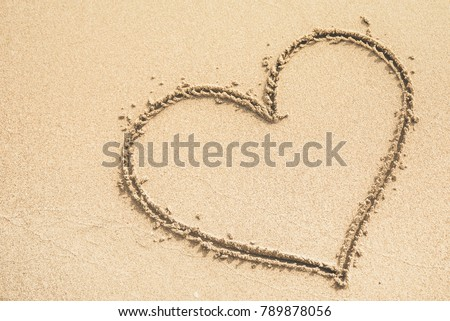 Heart written on the sand #789878056