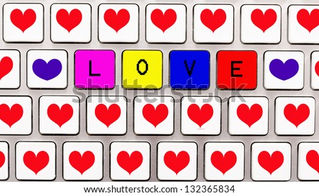 Hearts and love letters on the white keyboard