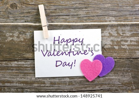 hearts and valentine`s day card with clothespins on wooden ground/ valentine`s day/hearts