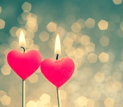 hearts candles on vintage bokeh as background vintage style, valentine day and love concept