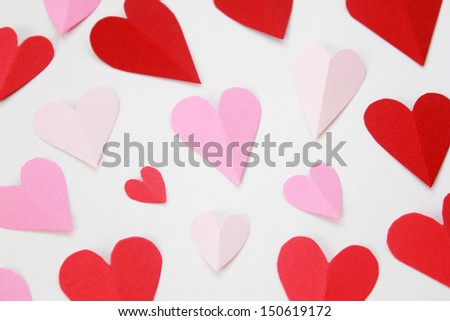 hearts cut from paper over white background