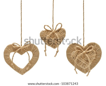 hearts decoration hanging on the ropes isolated on white