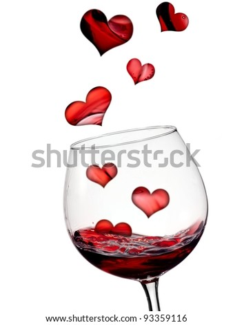 Hearts flying in glass with red wine