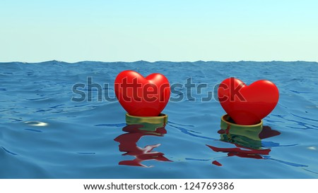 Hearts in gold wedding rings float at the ocean on a meeting each other.