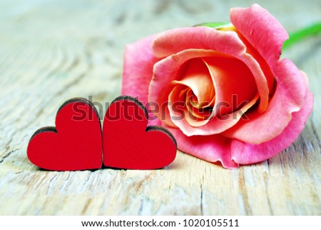 Hearts of lovers and a beautiful rose. Symbols of love. Valentine's Day. #1020105511