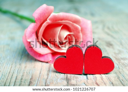 Hearts of lovers and a beautiful rose. Symbols of love. Valentine's Day. #1021226707