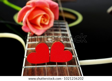 Hearts of lovers, beautiful rose and black acoustic guitar. Valentine's Day. #1021236202