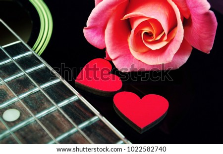 Hearts of lovers, beautiful rose and black acoustic guitar. Valentine's Day. #1022582740
