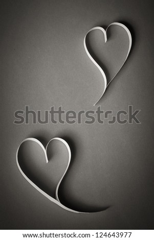 hearts of white paper on a gray background background on Valentine's Day
