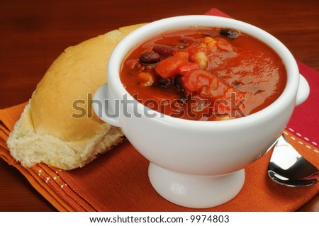 Hearty bowl of bean soup served with fresh bread.