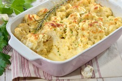 Hearty cauliflower gratin with eggs, natural yogurt and cheese freshly served from the oven