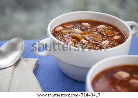Hearty winter vegetable and white bean soup on a rainy afternoon