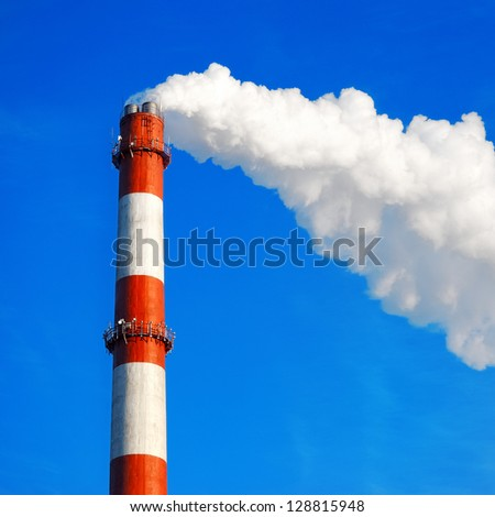 Heat and power central, smoke pipe against clear blue sky - stock photo