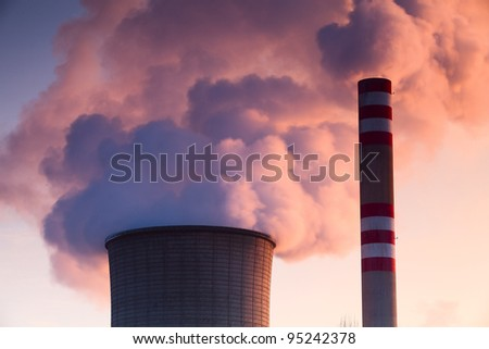 Heat and power central, smoke pipe against clear blue sky
