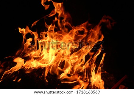 Heat energy heap closely, red and yellow, thermal energy at the fuel point during the night / lights on a black background