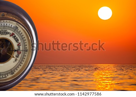 Heat wave. Barometer forecasting very dry weather against tropical sunshine background. Summer heatwave forecast with hot temperature and drought conditions. Global warming and climate change. #1142977586