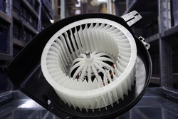 Heater fan of the air conditioning system of a modern car. Spare parts, car service.