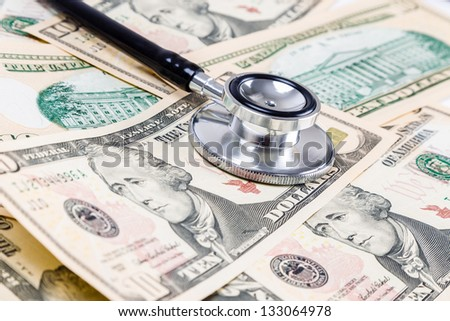 Heath care with US dollar bills and stethoscope