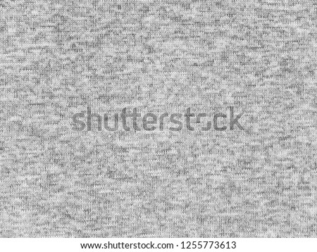 Heather gray polyester activewear fabric texture swatch. Synthetic material. #1255773613