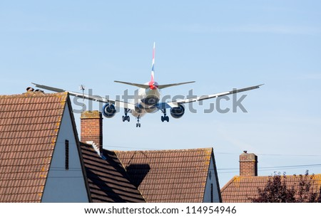 HEATHROW AIRPORT, LONDON - 9 SEPTEMBER: British Airways Boeing 777 approaches Heathrow on 9 September 2012. London Heathrow is the world's third busiest airport and a new runway is under discussion.