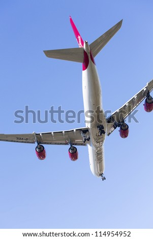HEATHROW AIRPORT, LONDON - 9 SEPTEMBER: VIrgin Atlantic A340 approaches Heathrow on 9 September 2012. London Heathrow is the world's third busiest airport and a new runway is under discussion.