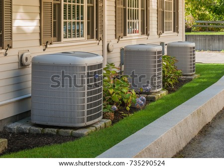 Heating and air conditioning inverters on the side of a condo