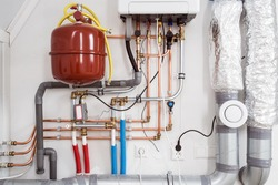 Heating installation and central boiler heating system on wall in house close-up