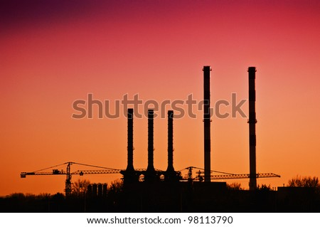 Heating plant chimneys against the sky