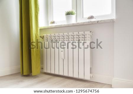 Heating white radiator radiator in living room.