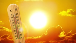 Heatwave hot sun. Climate Change. Global Warming. Thermometer high temperatures.