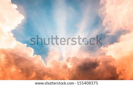 Heaven light ray from sun behind cloud in the blue sky