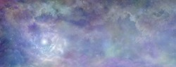 Heavenly clouds celestial  background banner - beautiful blue pink purple green lilac light filled heavenly ethereal cloudscape depicting the heavens above