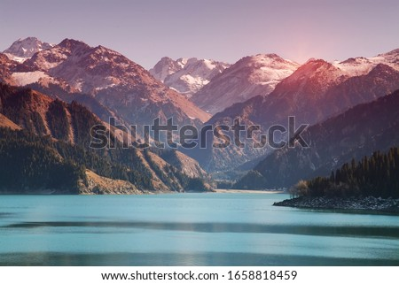 Photo of  Heavenly Lake with moutains, Xinjiang, China