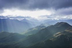 Heavenly light over dramatic mountains in Tasmania, Australia