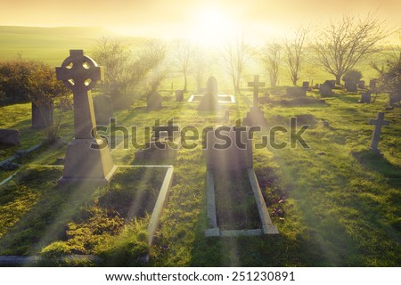 Heavenly light shining upon a old graveyard in England, United Kingdom.                                #251230891
