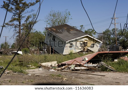 Heavily damaged homes in the Ninth Ward of New Orleans. .Behind these homes is the industrial canal the one that collapsed during the storm surge of hurricane Katrina.