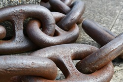 Heavy anchor chain coiled and ready for use.
