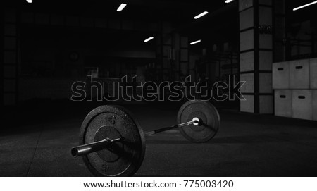 Heavy barbell on the floor of a gym studio copyspace bodybuilding weightlifting fitness power strength endurance agility workout exercising interior space crossfit box studio sportive lifestyle